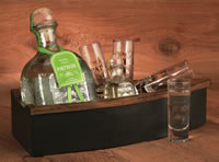 It's all about the Patron -Packaged in a wooden boat is a bottle of pure, ultra premium Patron Silver Tequila and along for the ride is a Miniature of ...